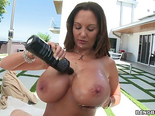 MILF Ava Addams lubes up her beamy juggs for POV titty job