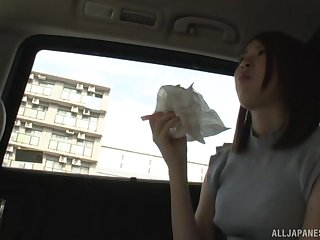Slender Japanese amateur seduced in a car and pussy teased