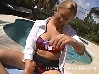 Oily POV handjob from a mature clothed babe by the pool