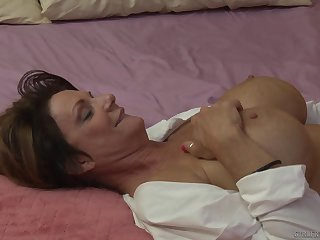 Blonde mature lesbians Dana DeArmond and Deauxma on the bed