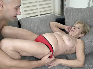 Mature blonde granny Malya gets cum on her freckled face