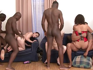 Alice Black and her girlfriends in an interracial hardcore orgy