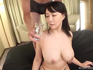 Busty Japanese MILF oiled up, fucked and cum sprayed on her face