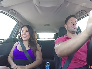 Curvy brunette MILF Candy rides a cock with her ass in the car