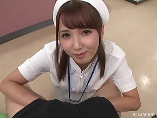 Japanese brunette teen in uniform takes a huge load down her throat