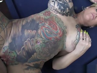 Mature Tattooed Blonde With Big Tits