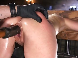 Restrained babe Lilly Lit squirts with respect to the place on every side the dark BDSM room