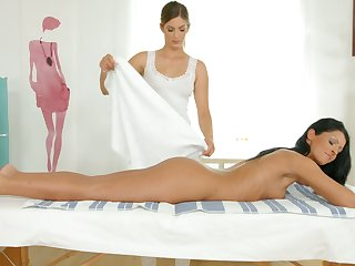 Hungarian babe Vivien Bell is licking wet pussy of sex-appeal masseuse