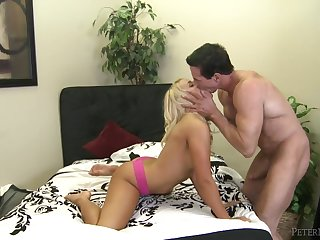 Peter North fucks a hot young blonde down the brush shaved pussy