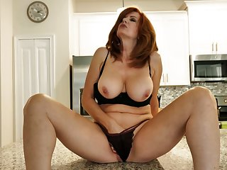 Red haired MILF undresses with the addition of plays with her titbit big boobies