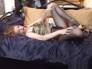Horny pantyhose babe masturbating