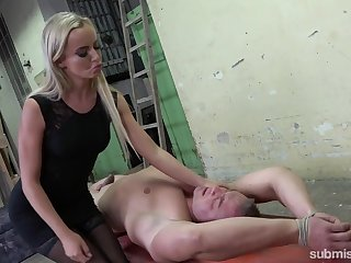 Sizzling mistress Victoria Pure is jerking off a dick be fitting of submissive guy