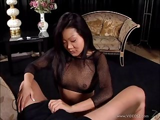 Seductive Asian cougar in fishnet stockings awarding her guy a superb handjob in a reality crone