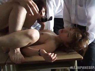 Hardcore gangbang on the table with clothed Japanese hottie