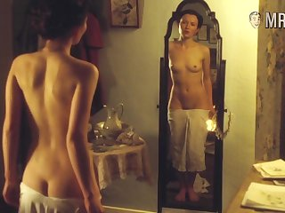 Hot celebrity enjoying the brush naked cogitation in the mirror