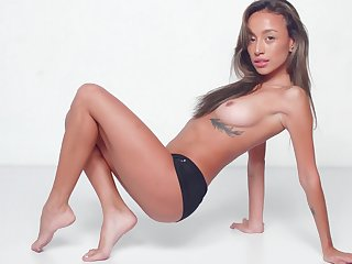 Warm nudity added to soft solo by a sexy Asian hon